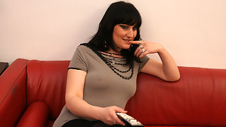 Horny mature slut masturbating on a couch