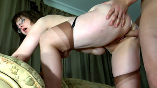 Randy mature exchanges oral favors with a stud and gets banged from behind