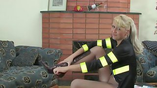 Uniformed babe changes into new grey pantyhose stretching and tasting them