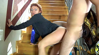 Dressed-up mature gal seducing her neighbor into hot coupling on the stairs
