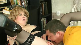 Naughty mature gal and younger guy getting down and dirty in various ways