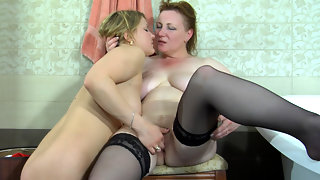 Greedy old dyke surprises a girl in the bathtub tasting her mouth and pussy