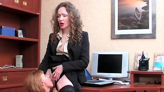 Lady-boss gets down to hot lesbian sex with French maid right in the office