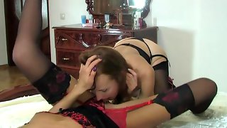 Awesome hottie in luxury stockings spreading her legs for lesbian workout