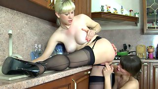 Outrageously hot lesbian chick shows her tongue skills right in the kitchen