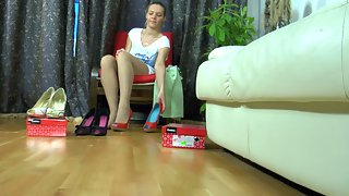 Tempting babe with well-maintained feet fits on new shoes and lacy tights