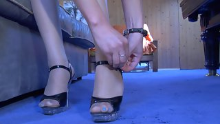 Naughty beauty readily showcasing her nyloned feet in spike heel sandals