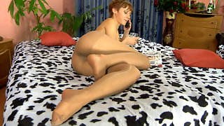 Awesome chick demonstrates her yummy feet in shiny hose while tasting wine