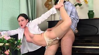 Cutie in barely visible stockings seducing pianist into cock-riding games