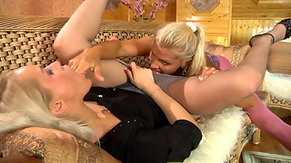 Nasty dyke in pink crotchless tights seduces her sexy lingerie consultant