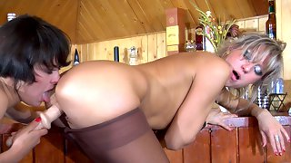 Heated girlfriends strip to their tight fitting nylon tights for dildo play