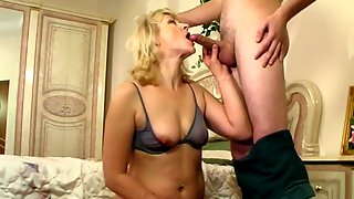 Oversexed mature blondie showing a kinky guy how to use his rock-hard shaft