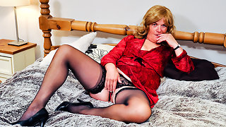 Horny mature housewife playing on her bed