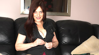 Horny housewife playing with her pussy on the couch