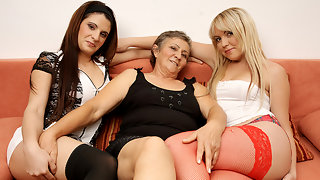 Three naughty old and young lesbians do it on the couch