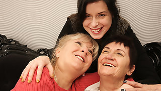 Two mature lesbians pleasing a hot young lesbian babe