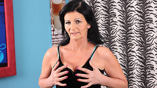 This naughty older mom loves to get wet on her couch