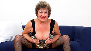 Naughty mature lady playing with her wet pussy
