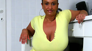 Big breasted MILF getting wet and wild