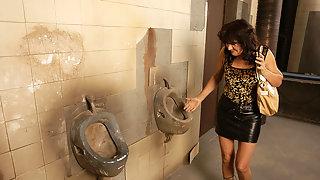 Horny mature slut caught on a public toilet