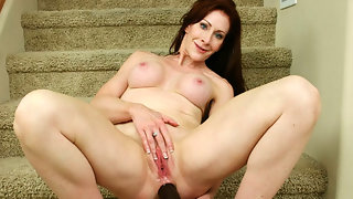 Mature redhead takes dildo in her ass
